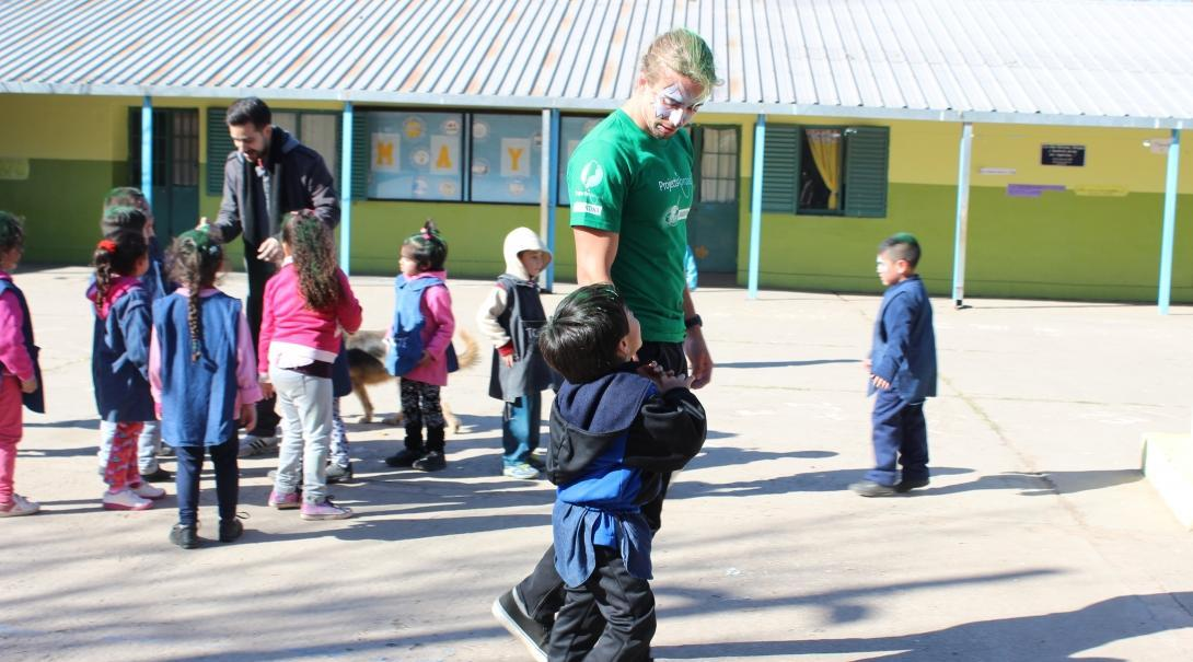A teenager spends time with children as part of his volunteer work in Argentina